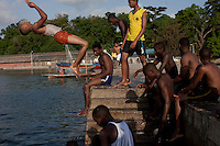 PEMBA, TANZANIA - DECEMBER 6 : Boys jump from the pier in the harbor on December 6, 2010 on Pemba, Tanzania. (Photo by: Per-Anders Pettersson)
