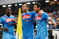 Blerim Dzemaili celebrates after scoring  against Genoa  with her teammate  Goran Pandev Sergi Armero during their Italian Serie A soccer match at the San Paolo  stadium in Naples April 7, 2013