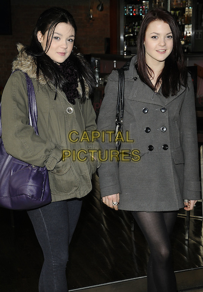 KATHERINE PRESCOTT & MEGAN PRESCOTT .At the Mother's Day brunch, Planet Hollywood, London, England, UK,.March 14th 2010..Mothering Sunday half length  sisters siblings family green khaki coat parka parker grey gray purple bag hands in pockets .CAP/CAN.©Can Nguyen/Capital Pictures