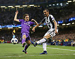 Luka Modric of Real Madrid in action with Leonardo Bonucci of Juventus during the Champions League Final match at the Millennium Stadium, Cardiff. Picture date: June 3rd, 2017.Picture credit should read: David Klein/Sportimage