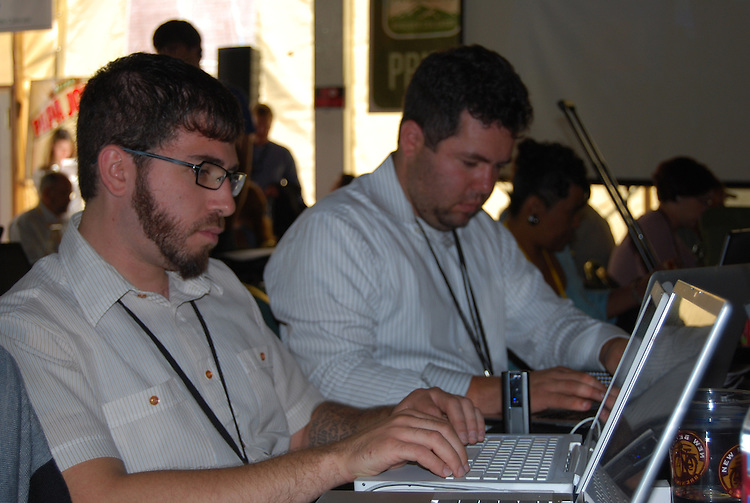 Spencer Ackerman, left, of the blog http://attackerman.firedoglake.com/ gets to work in the Big Tent new media center, sponsored by fellow blog The Daily Kos, Alliance for a Sustainable Colorado, and Progress Now. (Lauren Phillips, Congressional Quarterly Inc.)
