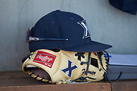 An Xavier Musketeers hat lays on a glove in the dugout during the game against the Penn State Nittany Lions at Coleman Field at the USA Baseball National Training Center on February 25, 2017 in Cary, North Carolina. The Musketeers defeated the Nittany Lions 10-4 in game one of a double header. (Brian Westerholt/Four Seam Images)