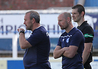 Queen of the South Manager Allan Johnston (right) and Assistant Manager Sandy Clark look on in a break in play in the SPFL Betfred League Cup group match between Queen of the South and Motherwell at Palmerston Park, Dumfries on 13.7.19.