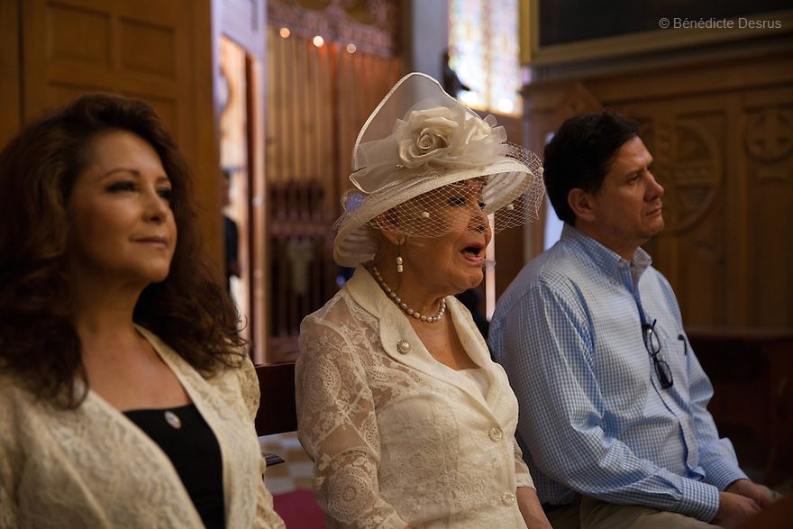 "August 8, 2015 - Mexico, Mexico City - Samantha is accompanied to her baptism by close friends and her godfather at the 'Sagrada Familia church' in Mexico City. Samantha Flores is an 83-year-old transgender woman from Veracruz, Mexico. She is a prominent social activist for LGBTQI rights and is the founder of the non-profit organization ""Laetus Vitae"", a day shelter for elderly gay people in Mexico City. Senior citizens in general are many times prone to neglect and abandonment by their families, leaving them all but invisible. Their plight can be even worse if they are homosexual. Photo credit: Bénédicte Desrus"