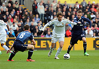 Pictured: Michu of Swansea (C) is closely marked by Scott Parker (L) and Gylfi Sigurdsson of Tottenham.  Saturday 30 March 2013<br />