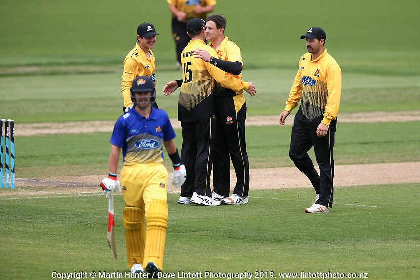 Wellington players celebrate a wicket during the Wellington Firebirds v Otago Volts, Ford Trophy One Day match round five at Bert Sutcliffe Oval in Lincoln, New Zealand on Friday, 29 November 2019. Photo: Martin Hunter / lintottphoto.co.nz
