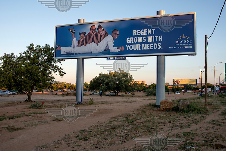 A billboard advertisement for an insurance company featuring a woman and three children.