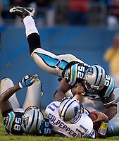 Carolina Panthers linebacker Jon Beason (52) and linebacker Thomas Davis (58) against Detroit Lions quarterback Daunte Culpepper (11) during an NFL football game at Bank of America Stadium in Charlotte, NC.