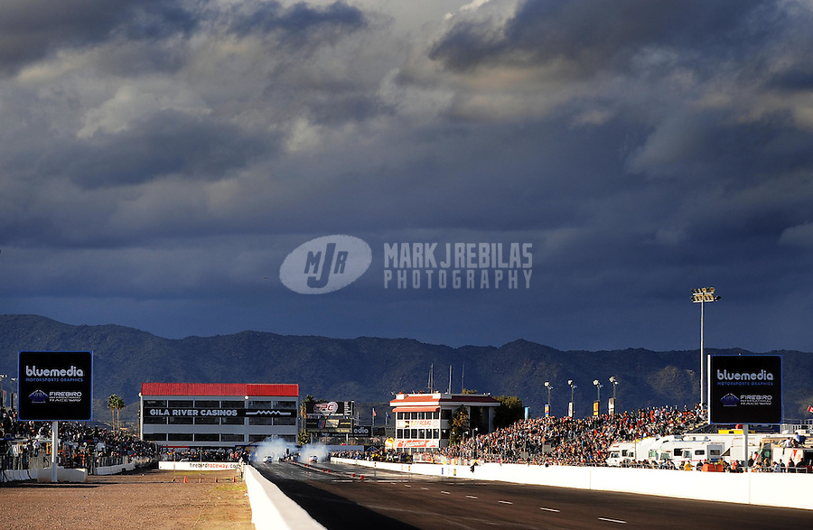 Feb. 20, 2010; Chandler, AZ, USA; NHRA pro stock drivers do their burnouts during qualifying for the Arizona Nationals at Firebird International Raceway. Mandatory Credit: Mark J. Rebilas-