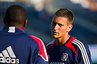 Chicago Fire goalkeeper coach Aron Hyde talks with goalkeeper Sean Johnson (25) prior to playing the Philadelphia Union. The Chicago Fire defeated the Philadelphia Union 3-1 during a Major League Soccer (MLS) match at PPL Park in Chester, PA, on August 12, 2012.