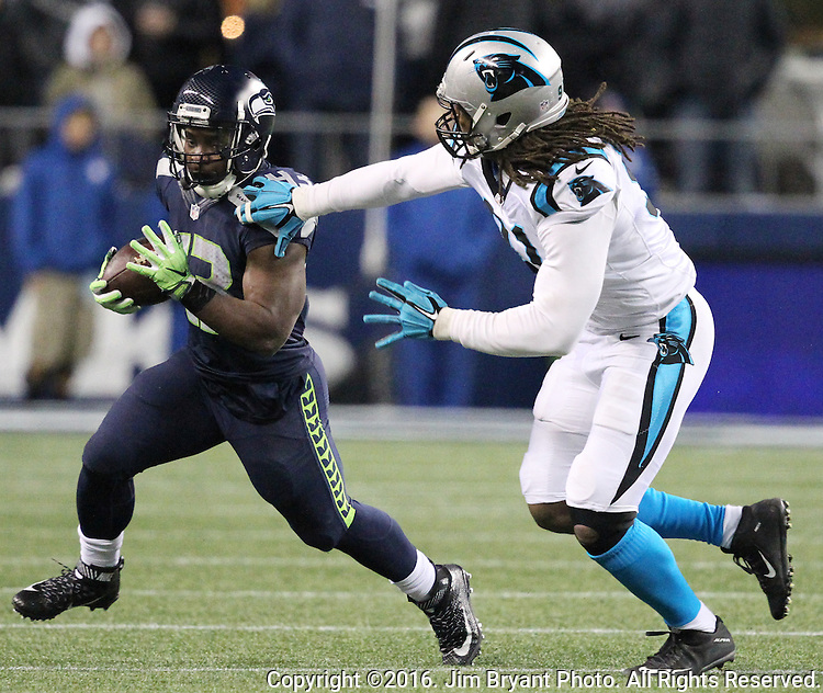 Seattle Seahawks running back Troymaine Pope (43) runs past Carolina Panthers defensive end Ryan Delaire (91) at CenturyLink Field in Seattle, Washington on December 4, 2016.  Seahawks beat the Panthers 40-7.  ©2016. Jim Bryant photo. All Rights Reserved.