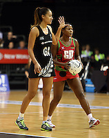 31.10.2013 Silver Fern Maria Tutaia and Malawi's Caroline Mtukule in action during the Silver Ferns V Malawi during the New World Netball Series played at the Claudelands Arena in Hamilton. Mandatory Photo Credit ©Michael Bradley.