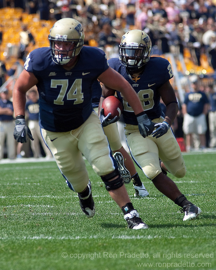 Pitt outside linebacker John Malecki (74) blocks for running back Dion Lewis. The Pittsburgh Panthers defeated the Youngstown State Penguins 38-3 at Heinz Field on September 5, 2009.