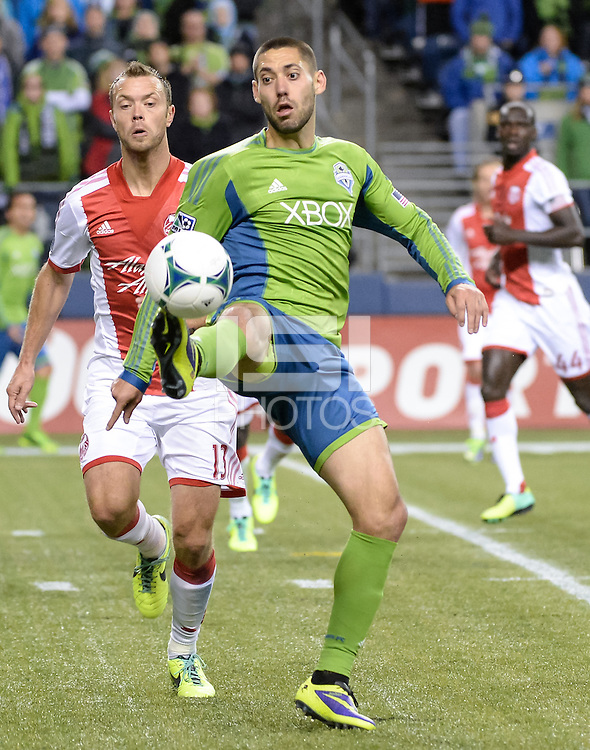 November, 2013: CenturyLink Field, Seattle, Washington:  Seattle Sounders FC forward Clint Dempsey (2) high kicks the ball as the Portland Timbers take on the Seattle Sounders FC in the Major League Soccer Playoffs semifinals Round. Portland won the first match 2-1.
