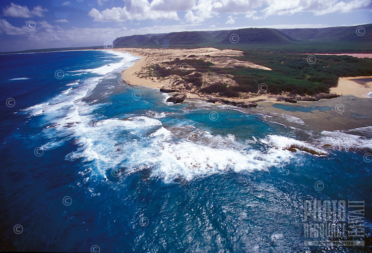 Niihau Coastline seen from the air. Pristine natural coastline, white sand beaches,  reefs, and clear blue water.
