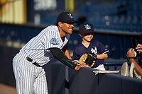 Tampa Tarpons Timothy Robinson (30) poses for a photo with a young fan before a game against the Fort Myers Miracle on May 2, 2018 at George M. Steinbrenner Field in Tampa, Florida.  Fort Myers defeated Tampa 5-0.  (Mike Janes/Four Seam Images)