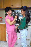 Vietnamese mother age 45 scolding 17 year old daughter.  St Paul Minnesota USA