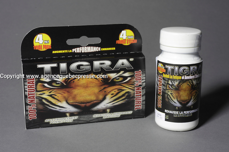 Montreal (Qc) CANADA - June 2 2012 -  TIGRA  : 100 % natural, 100 % made in quebec male enhancement potency pill - 4 pieces trial package (L) and 24 pieces bottle (R) French label