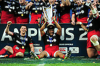 Mako Vunipola of Saracens celebrates with the European Rugby Champions Cup trophy. European Rugby Champions Cup Final, between Saracens and Racing 92 on May 14, 2016 at the Grand Stade de Lyon in Lyon, France. Photo by: Patrick Khachfe / Onside Images