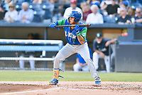 Lexington Legends Jeison Guzman (7) squares to bunt during a game against the Asheville Tourists at McCormick Field on July 1, 2019 in Asheville, North Carolina. The Tourists defeated the Legends 9-8. (Tony Farlow/Four Seam Images)