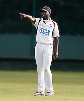 Hornsey captain Garfield Struthers directs his field during the Middlesex Cricket League Division Two game between Shepherds Bush and Hornsey at Bromyard Ave, London on Sat Aug 1, 2015