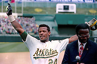 OAKLAND, CA - Rickey Henderson of the Oakland Athletics smiles and talks with Lou Brock after setting the all time career stolen base record by stealing base #939 during a game against the New York Yankees at the Oakland Coliseum in Oakland, California on May 1, 1991. Photo by Brad Mangin