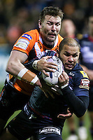 Picture by Alex Whitehead/SWpix.com - 06/03/2015 - Rugby League - First Utility Super League - Castleford Tigers v Wigan Warriors - the Mend A Hose Jungle, Castleford, England - Wigan's Matty Bowen is tackled by Castleford's Michael Shenton.