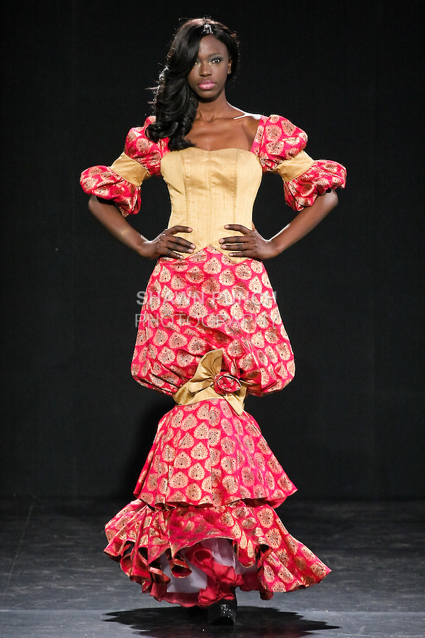 Models walk runway in a Reedas outfit by Rukkayah Sueiman, during Couture Fashion Week Fall 2011 in New York.
