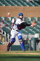 Surprise Saguaros catcher Matt Whatley (25), of the Texas Rangers organization, throws to first base during the Arizona Fall League Championship Game against the Salt River Rafters on October 26, 2019 at Salt River Fields at Talking Stick in Scottsdale, Arizona. The Rafters defeated the Saguaros 5-1. (Zachary Lucy/Four Seam Images)