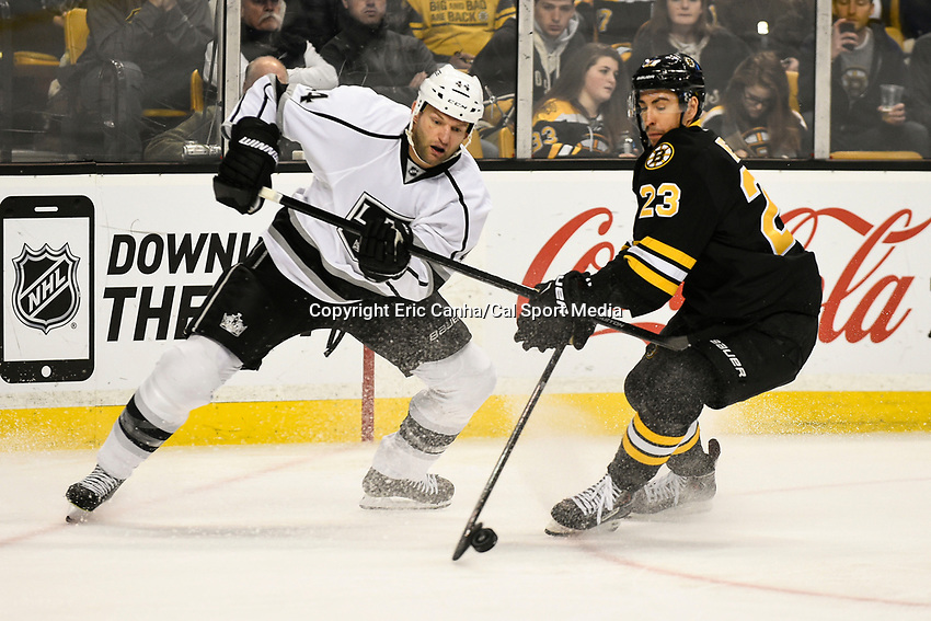 January 31, 2015 - Boston, Massachusetts, U.S. - Boston Bruins center Chris Kelly (23) gets control of the puck in front of Los Angeles Kings defenseman Robyn Regehr (44) during the third period of the NHL game between the Los Angeles Kings and the Boston Bruins held at TD Garden in Boston Massachusetts. The Bruins defeated the Kings 3-1 in regulation time. Eric Canha/CSM