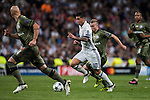 James Rodriguez of Real Madrid competes for the ball with Thibault Moulin of Legia Warszawa during the 2016-17 UEFA Champions League match between Real Madrid and Legia Warszawa at the Santiago Bernabeu Stadium on 18 October 2016 in Madrid, Spain. Photo by Diego Gonzalez Souto / Power Sport Images