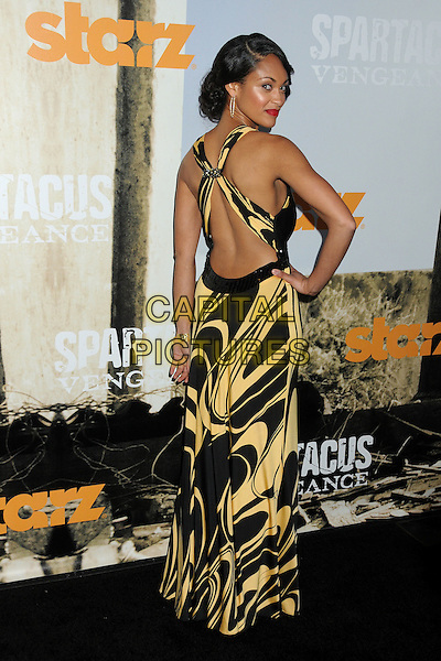 "Cynthia Addai-Robinson.""Spartacus: Vengeance"" Premiere Screening held at Arclight Cinemas, Hollywood, California, USA..January 18th, 2012.full length backless dress maxi black yellow print looking over shoulder hand on hip.CAP/ADM/BP.©Byron Purvis/AdMedia/Capital Pictures."