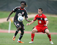 Joseph Ngwenya (11) of D.C. United shields the ball from Alex Lee (18)  during a scrimmage against the University of Maryland at Ludwig Field, University of Maryland, College Park, on April  10 2011. D.C. United won 1-0.
