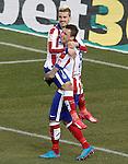 Atletico de Madrid's Antoine Griezmann (l) and Mario Mandzukic celebrate goal during La Liga match.February 21,2015. (ALTERPHOTOS/Acero)