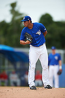 Dunedin Blue Jays pitcher Alonzo Gonzalez (6) looks in for the sign during the second game of a doubleheader against the Palm Beach Cardinals on August 2, 2015 at Florida Auto Exchange Stadium in Dunedin, Florida.  Dunedin defeated Palm Beach 2-0.  (Mike Janes/Four Seam Images)