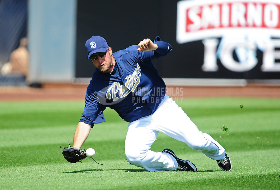 Mar. 27, 2012; Peoria, AZ, USA; San Diego Padres outfielder Mark Kotsay fails to make a catch in the third inning against the Los Angeles Dodgers at Peoria Stadium.  Mandatory Credit: Mark J. Rebilas-