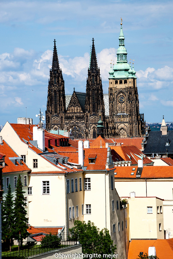 View to Sct. Vitus Cathedral from the Strahov Monestary in Prague. In front Part of the white buildings with the red tile roofs along the street that leads to the center of Prague.<br /> The Metropolitan Cathedral of Saints Vitus, Wenceslaus and Adalbert (Czech: metropolitn&iacute; katedr&aacute;la svat&eacute;ho V&iacute;ta, V&aacute;clava a Vojtěcha) is a Roman Catholic metropolitan cathedral in Prague, the seat of the Archbishop of Prague. Up to 1997, the cathedral was dedicated only to Saint Vitus, and is still commonly named only as St. Vitus Cathedral.<br /> <br /> This cathedral is an excellent example of Gothic architecture and is the biggest and most important church in the country. Located within Prague Castle and containing the tombs of many Bohemian kings and Holy Roman Emperors, the cathedral is under the ownership of the Czech government as part of the Prague Castle complex.Cathedral dimensions are 124 &times; 60 meters, the main tower is 96.5 meters high, front towers 82 m, arch height 33.2 m
