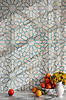 Castilla, a jewel glass waterjet and hand-cut mosaic shown in Quartz and Aquamarine, is part of the Miraflores collection by Paul Schatz for New Ravenna.