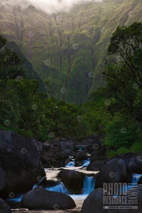 The emerald green walls of Kauai's Waialeale glow at twilight
