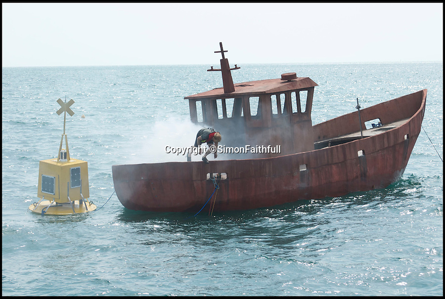BNPS.co.uk (01202 558833)<br /> Pic: GavinWeber/BNPS<br /> <br /> ***Please Use Full Byline***<br /> <br /> British artist Simon Faithfull jumping from the sinking boat. <br /> <br /> Sunk without a trace...<br /> <br /> Taxpayers have forked out tens of thousands of pounds to pay for the sinking of a concrete fishing boat in the name of art.<br /> <br /> British artist Simon Faithfull bought a boat on eBay with public funds then scuttled it in a dramatic display off the coast of Weymouth, Dorset.<br /> <br /> It is hoped the boat, which now lies around 80ft below the surface, will form an artificial reef to support marine life in Ringstead Bay, Weymouth.<br /> <br /> But there was outrage today after it emerged the project was part-funded by the British taxpayer through grants from the Arts Council.<br /> <br /> Almost half of the 120,000 pounds project cost was met by Arts Council money with the rest coming through European arts grants.