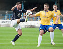Dundee's Peter MacDonald and Cowdenbeath's John Armstrong challenge for the ball.