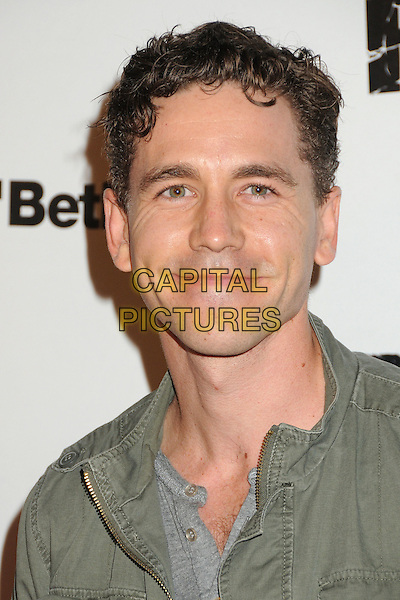 """Brian Dietzen.""""Rage"""" Video Game Launch Party held in Chinatown's Historical Central Plaza, Los Angeles, California, .30 September 2011..portrait headshot green .CAP/ADM/BP.©Byron Purvis/AdMedia/Capital Pictures."""