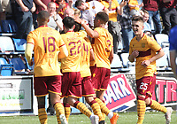 Jermaine Hylton (14) being congratulated by Motherwell players after scoring the third goal in the SPFL Betfred League Cup group match between Queen of the South and Motherwell at Palmerston Park, Dumfries on 13.7.19.