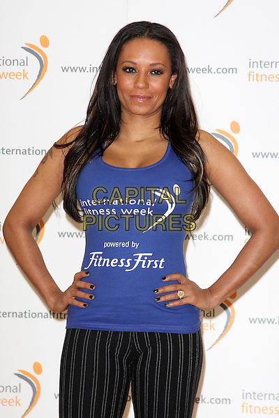MEL B - MELANIE BROWN.Launches International Fitness Week at Fitness First, Tottenham Court Road, London -  .January 28th, 2010.half length scary spice blue purple tank top hands on hips ring tattoos nail varnish polish .CAP/ROS.©Steve Ross/Capital Pictures.