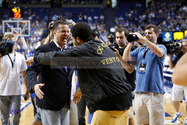 Coach John Calipari, left, and Drake, right, greet each other before the Alumni Charity Basketball Game at Rupp Arena in Lexington, Ky., on Saturday, September 15, 2012. Photo by Tessa Lighty | Staff
