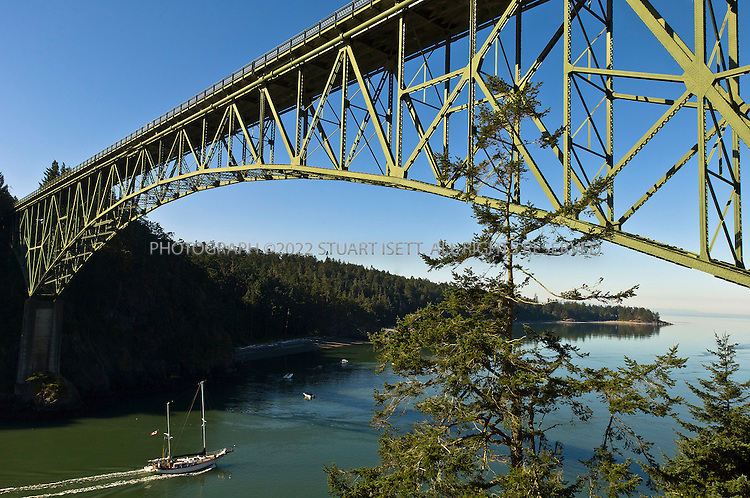 9/11/2007--Whidbey Island, WA, USA...Upon completion in July 1935, the 976 foot span Deception Pass Bridge connected Whidbey Island to the tiny Pass Island, and Pass Island to Fidalgo Island. Prior to the bridge, travellers and businessmen would use an inter-island ferry to commute between Fidalgo and Whidbey islands...Whidbey Island can be a place of both geological and cultural extremes.  In a single hour's drive - about how long it takes to traverse the entire island North to South by car - you will pass through all and sundry topography: tunnels of towering redwoods, bucolic farmland dotted with barns and grazing horses, stunning vistas of sparkling bays.  And you're just as likely to spot a bald eagle soaring overhead as you are one of the military aircraft that thunder through the sky.  The breath-taking Deception Pass that links  Whidbey to Fidalgo Island can be visited  by foot, by car and by local jet boats. Whidbey is home to Top Gun mavericks and their flag-waving families as well as hippie peaceniks and dreamy-eyed artists...©2007 Stuart Isett. All rights reserved