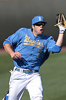 Cody Keefer #7 of the UCLA Bruins catches a fly ball during a game against the Baylor Bears at Jackie Robinson Stadium on February 25, 2012 in Los Angeles,California. UCLA defeated Baylor 9-3.(Larry Goren/Four Seam Images)