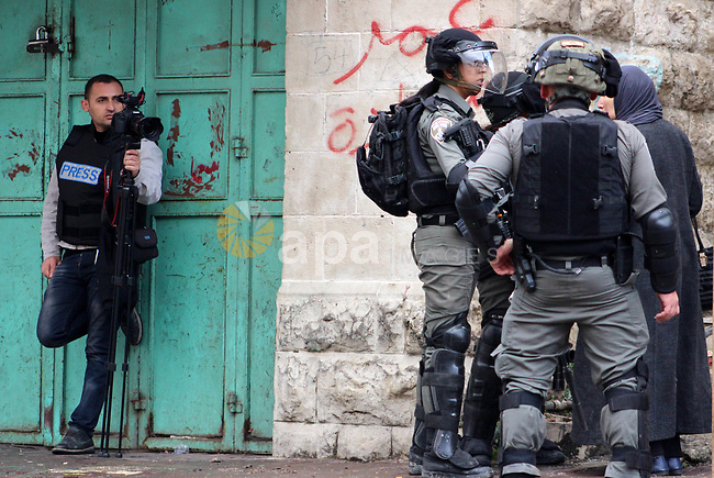 Israeli security forces arrest Palestinian youth during a protest over a U.S. decision on Jewish settlements, in the West Bank city of Hebron on December 9, 2019. Photo by Mosab Shawer