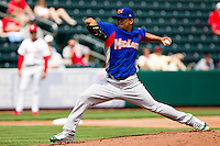 Carlos Hernandez (11) of the Midland RockHounds delivers a pitch during a game against the Springfield Cardinals on April 19, 2011 at Hammons Field in Springfield, Missouri.  Photo By David Welker/Four Seam Images