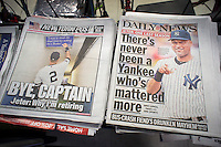 Headlines of New York newspapers are seen on Thursday, February 13, 2014 reporting on NY Yankee Derek Jeter announcing that he will retire after the current season. The 41 year old Jeter will have played 20 seasons with the Yankees with five world series titles.  (© Richard B. Levine)